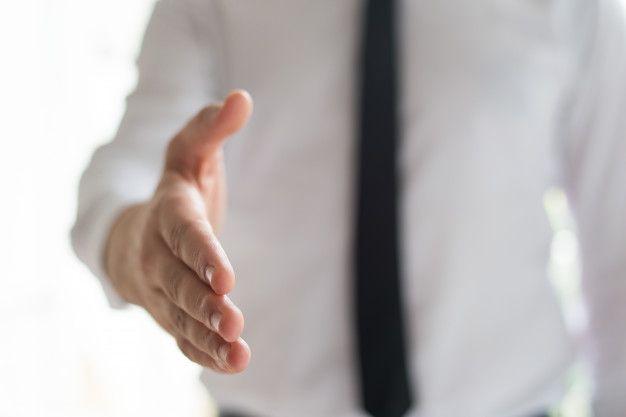 businessman-offering-hand-handshake_1262-18153
