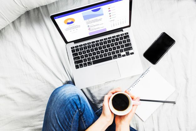 person-bed-with-coffee-cup-laptop_23-2147962692